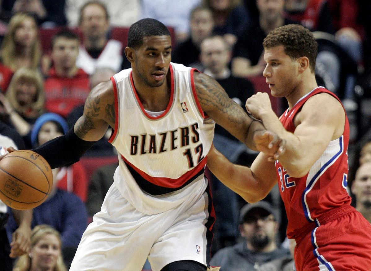 Portland Trail Blazers forward LaMarcus Aldridge, left, tries to move to the basket against Los Angeles Clippers forward Blake Griffin during the first quarter of their NBA basketball game in Portland, Ore., Tuesday, Jan. 10, 2012.(AP Photo/Don Ryan)