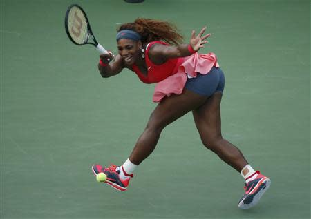 Serena Williams of the U.S. hits a return to compatriot Stephens at the U.S. Open tennis championships in New York