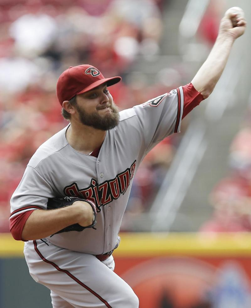 Dbacks hold on to beat Reds 5-4