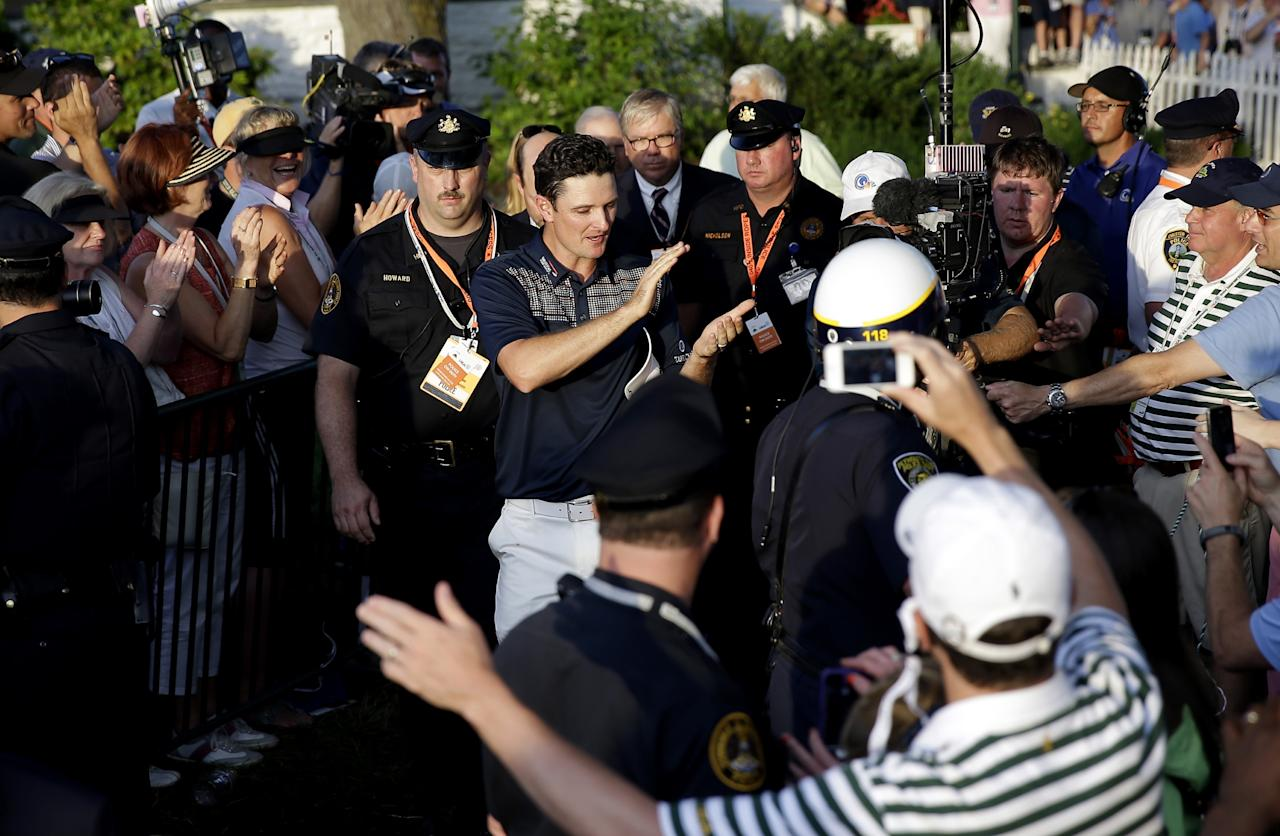 ARDMORE, PA - JUNE 16: Justin Rose of England is congratulated as he walks to the trophy presentation after winning the 113th U.S. Open at Merion Golf Club on June 16, 2013 in Ardmore, Pennsylvania. (Photo by Rob Carr/Getty Images)