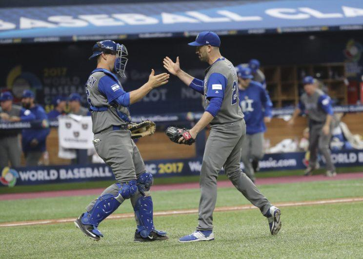 Israel's pitcher Josh Zeid right celebrates his team's victory with catcher Ryan Lavarnway against South Korea after the first round game of the World Baseball Classic at Gocheok Sky Dome in Seoul South Korea Monday