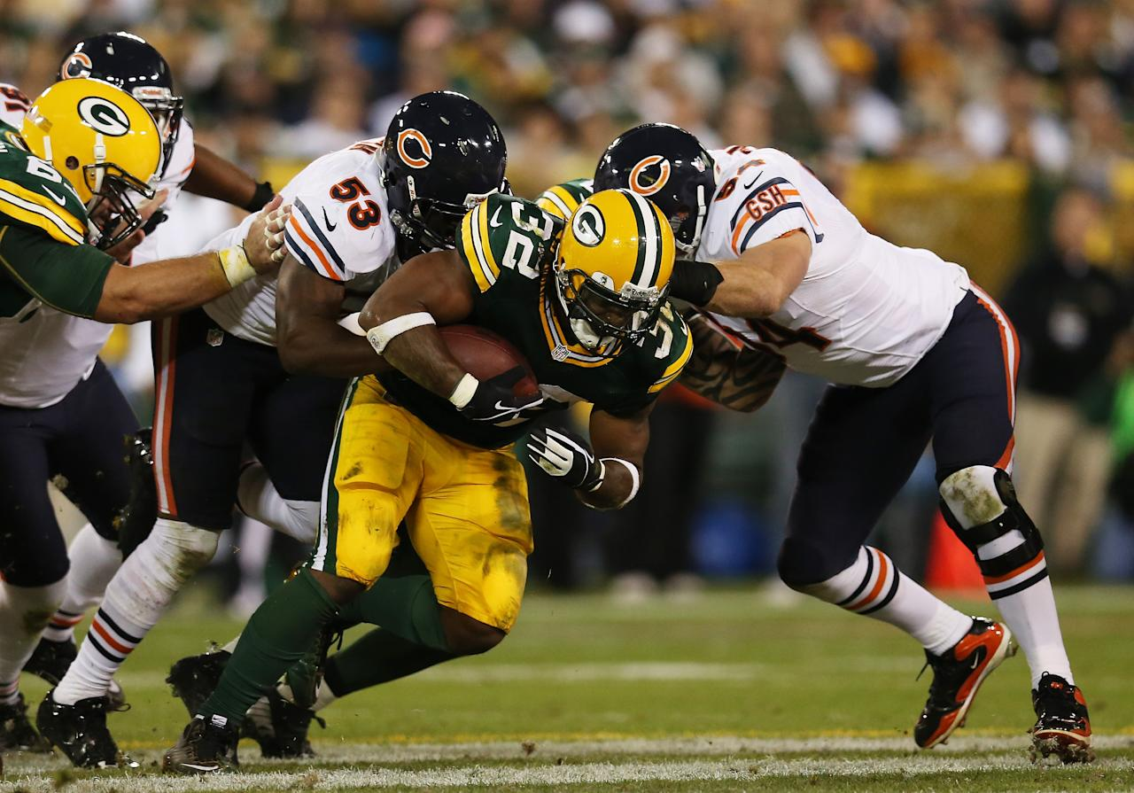 GREEN BAY, WI - SEPTEMBER 13:  Running back Cedric Benson #32 of the Green Bay Packers carries the ball against the defense of outside linebacker Nick Roach #53 and middle linebacker Brian Urlacher #54 of the Chicago Bears in the first quarter at Lambeau Field on September 13, 2012 in Green Bay, Wisconsin.  (Photo by Jonathan Daniel/Getty Images)