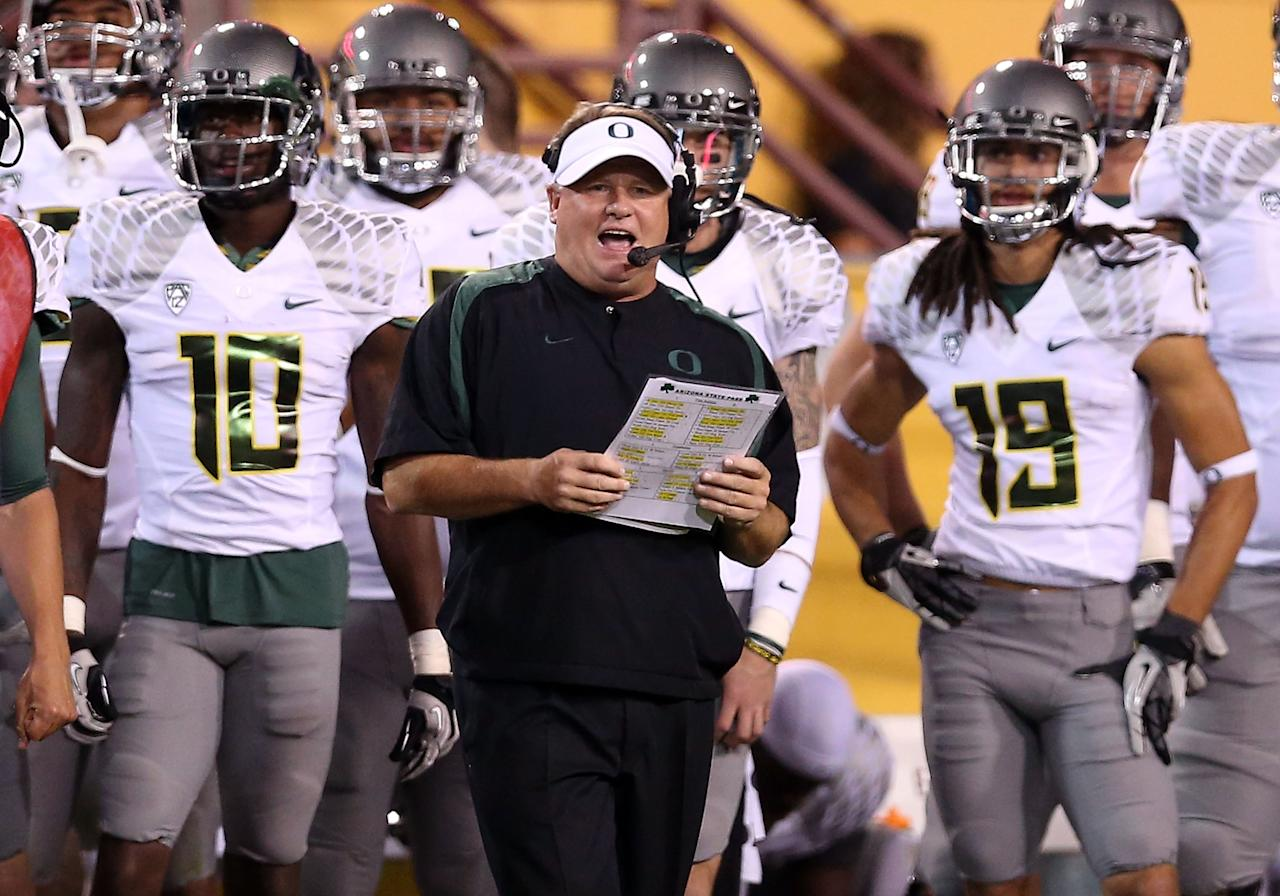 TEMPE, AZ - OCTOBER 18:  Head coach Chip Kelly of the Oregon Ducks reacts from the sidelines during the college football game against the Arizona State Sun Devils at Sun Devil Stadium on October 18, 2012 in Tempe, Arizona.  (Photo by Christian Petersen/Getty Images)