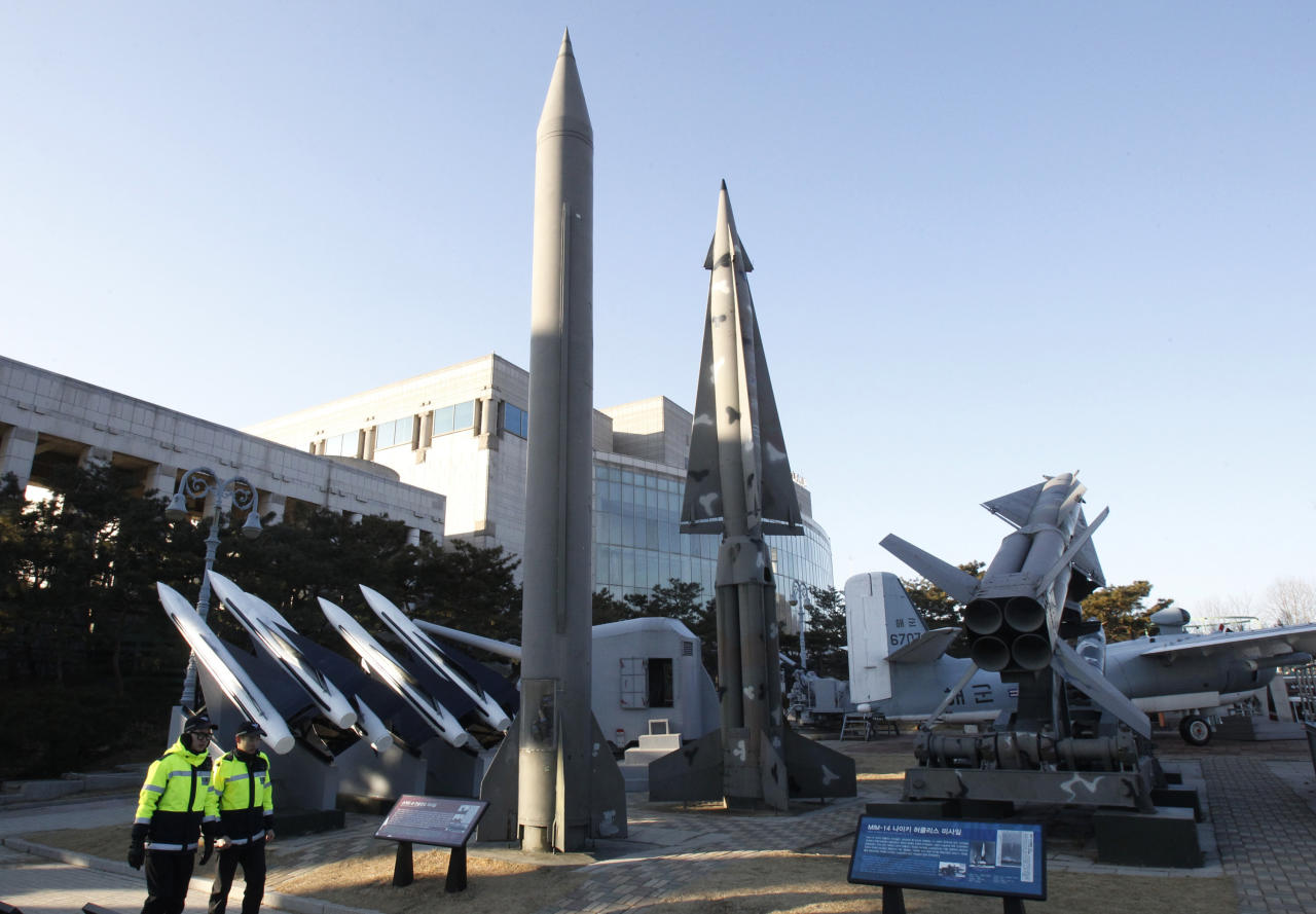 South Korean police officers walk by models of North Korea's Scud-B missile, center left, and other South Korean missiles on display at Korea War Memorial Museum in Seoul, South Korea. Friday, Jan. 25, 2013. South Korea's President Park Geun-hye is strongly urging North Korea to refrain from conducting a nuclear test that could only worsen the tensions on the Korean Peninsula in the wake of a provocative long-range rocket launch in December, envoy Rhee In-je told The Associated Press and selected news outlets in Davos, Switzerland. (AP Photo/Ahn Young-joon)