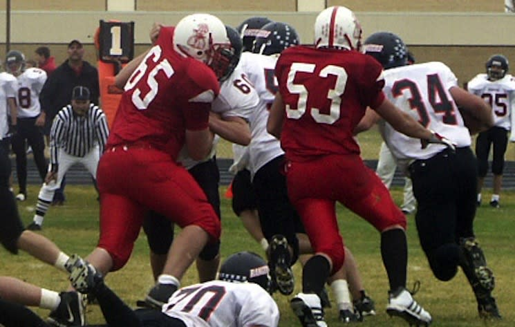 The Big Piney Punchers compete with a wild cowboy on their helmets — Big Piney High School