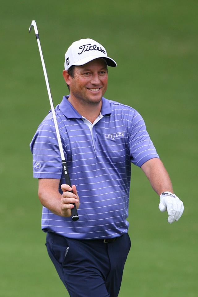 GREENSBORO, NC - AUGUST 18: Tim Clark of South Africa smiles after hitting his second shot on the 11th hole during the third round of the Wyndham Championship at Sedgefield Country Club on August 18, 2012 in Greensboro, North Carolina. (Photo by Hunter Martin/Getty Images)