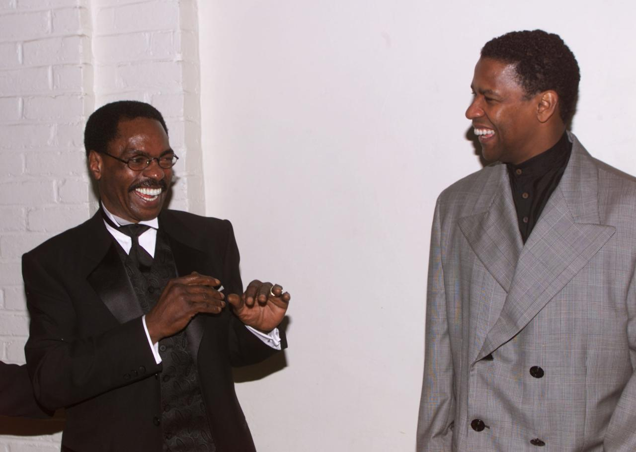 """Rubin """"Hurricane"""" Carter (L) poses with actor Denzel Washington at the premier of the film """"The Hurricane"""" in this file photo taken in Los Angeles December 14, 1999. Carter died on April 20, 2014, in Toronto after a battle with prostate cancer. He was 76. REUTERS/Fred Prouser/Files (UNITED STATES - Tags: ENTERTAINMENT SPORT OBITUARY)"""