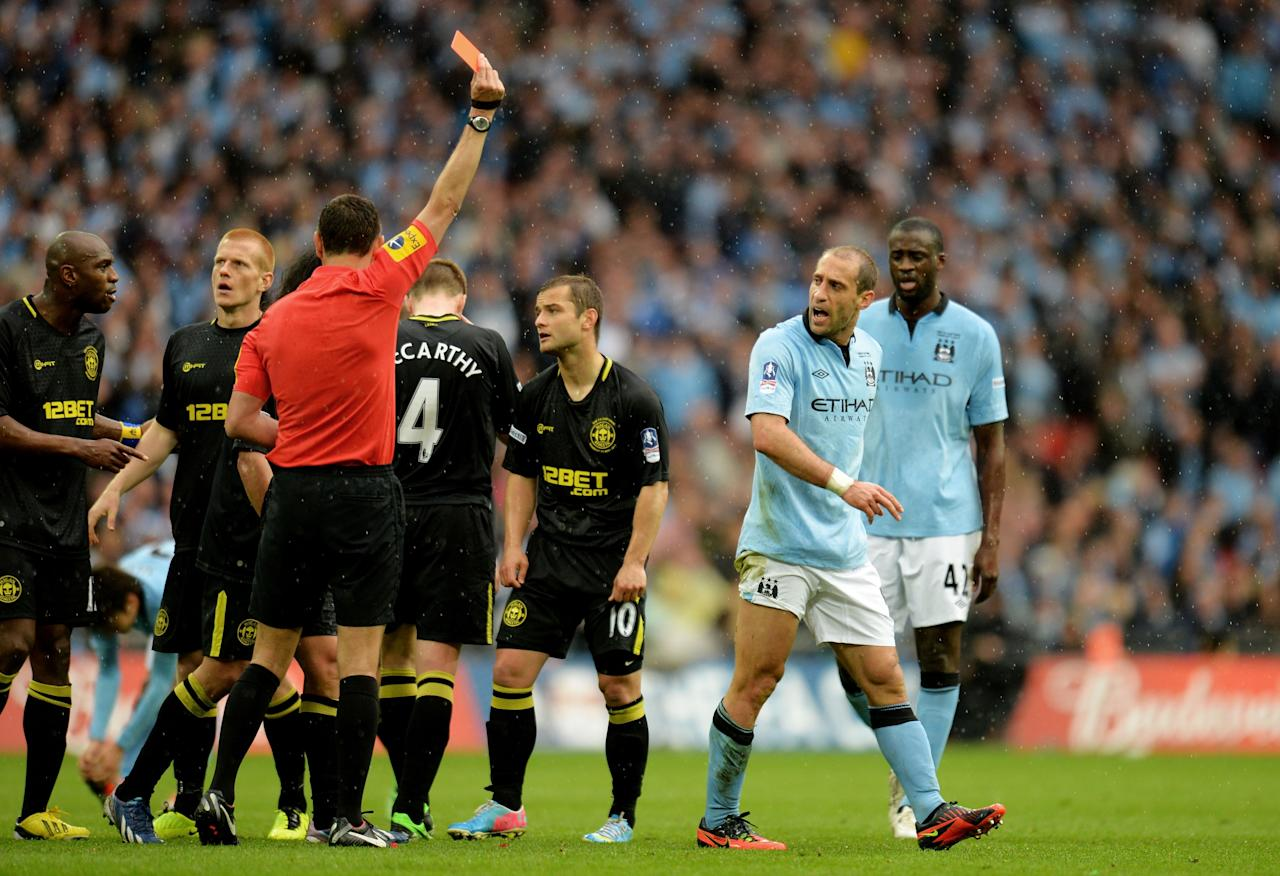 LONDON, ENGLAND - MAY 11:  Pablo Zabaleta of Manchester City (2R) is sent off by referee Andre Marriner during the FA Cup with Budweiser Final between Manchester City and Wigan Athletic at Wembley Stadium on May 11, 2013 in London, England.  (Photo by Shaun Botterill/Getty Images)