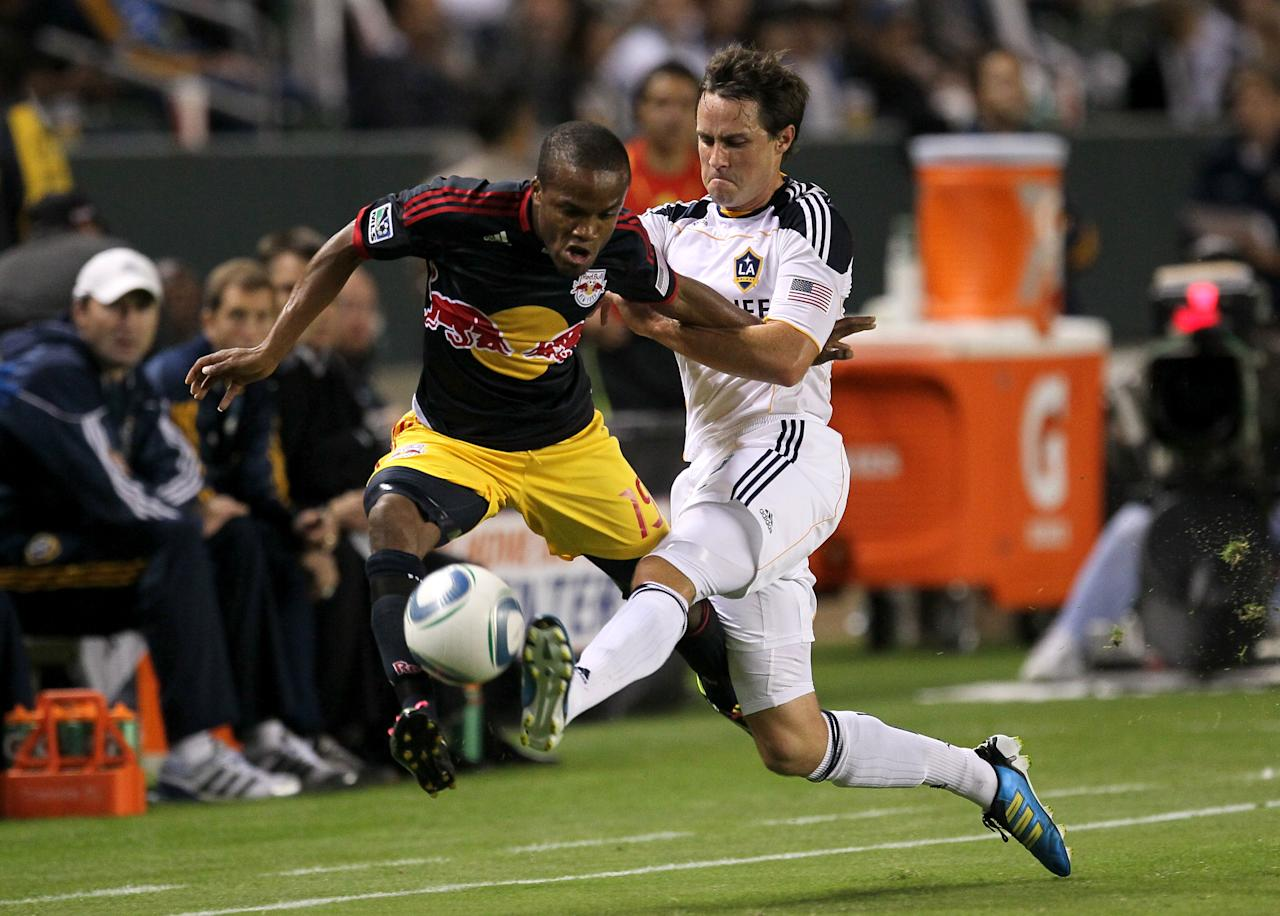 CARSON, CA - NOVEMBER 03:  Dane Richards #19 of the New York Red Bulls battles for the ball with Todd Dunivant #2 of the Los Angeles Galaxy in their Western Conference Semifinal at The Home Depot Center on September 9, 2011 in Carson, California.  The Galaxy won 2-1 to advance to the Conference Finals.  (Photo by Stephen Dunn/Getty Images)