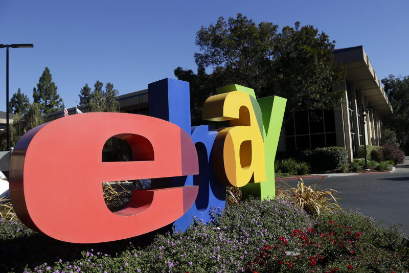 An eBay sign decorates the front of the company's headquarters in San Jose, Calif., Wednesday, Oct.  17, 2012. EBay said its third-quarter net income grew 22 percent, helped by higher revenue at its PayPal payments service and the marketplaces business that includes eBay.com. (AP Photo/Marcio Jose Sanchez)