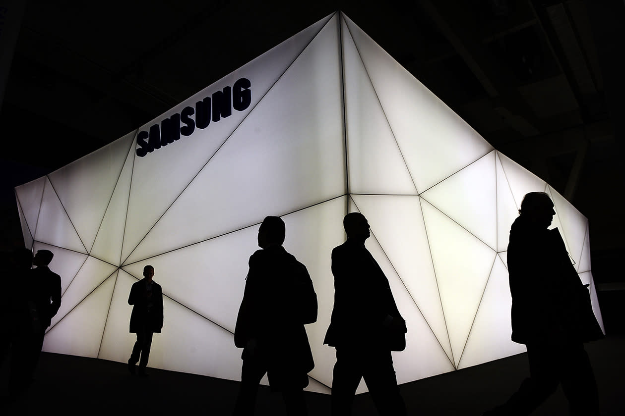 Visitors walk at the Mobile World Congress, the world's largest mobile phone trade show.
