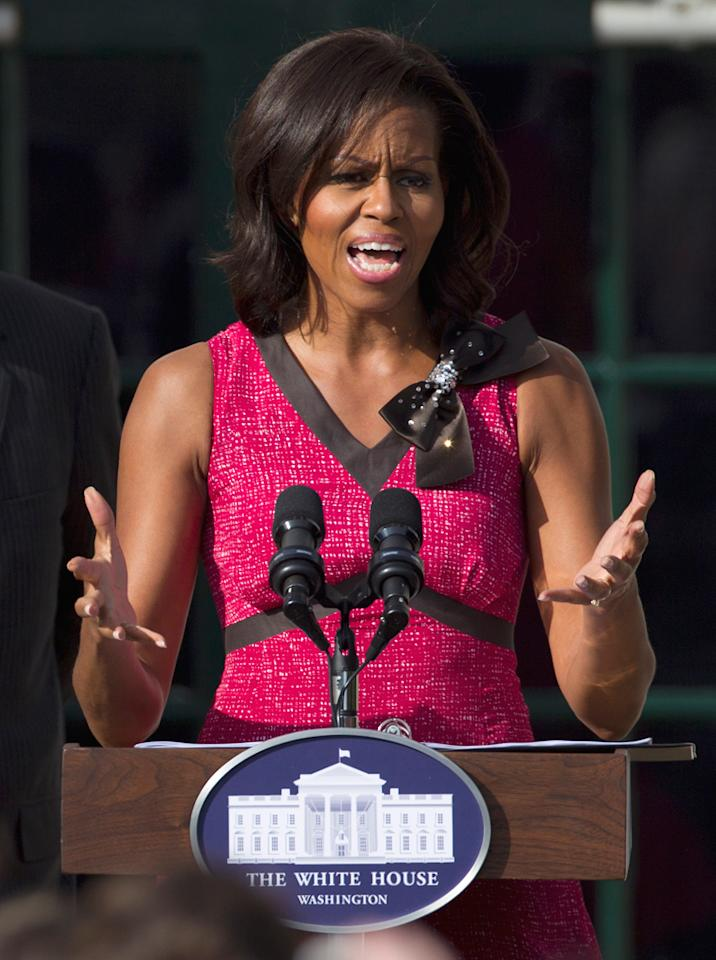 Photo by: (AP Photo/Carolyn Kaster)<br />Michelle Obama speaks on the South Lawn of the White House in Washington, Oct. 17, 2011-<br />First lady Michelle Obama speaks on the South Lawn of the White House in Washington, Monday, Oct. 17, 2011, during an event to honor schools that met the first lady's goal to double the number of participants in the HealthierUS School Challenge in year.