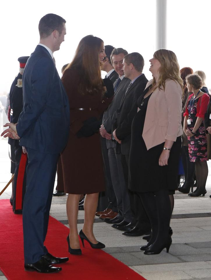 GRIMSBY, ENGLAND - MARCH 05:  Catherine, Duchess of Cambridge speaks with a pregnant woman during a visit to the Havelock Academy  on March 5, 2013 in Grimsby, England.  (Photo Darren Staples - WPA Pool/Getty Images)