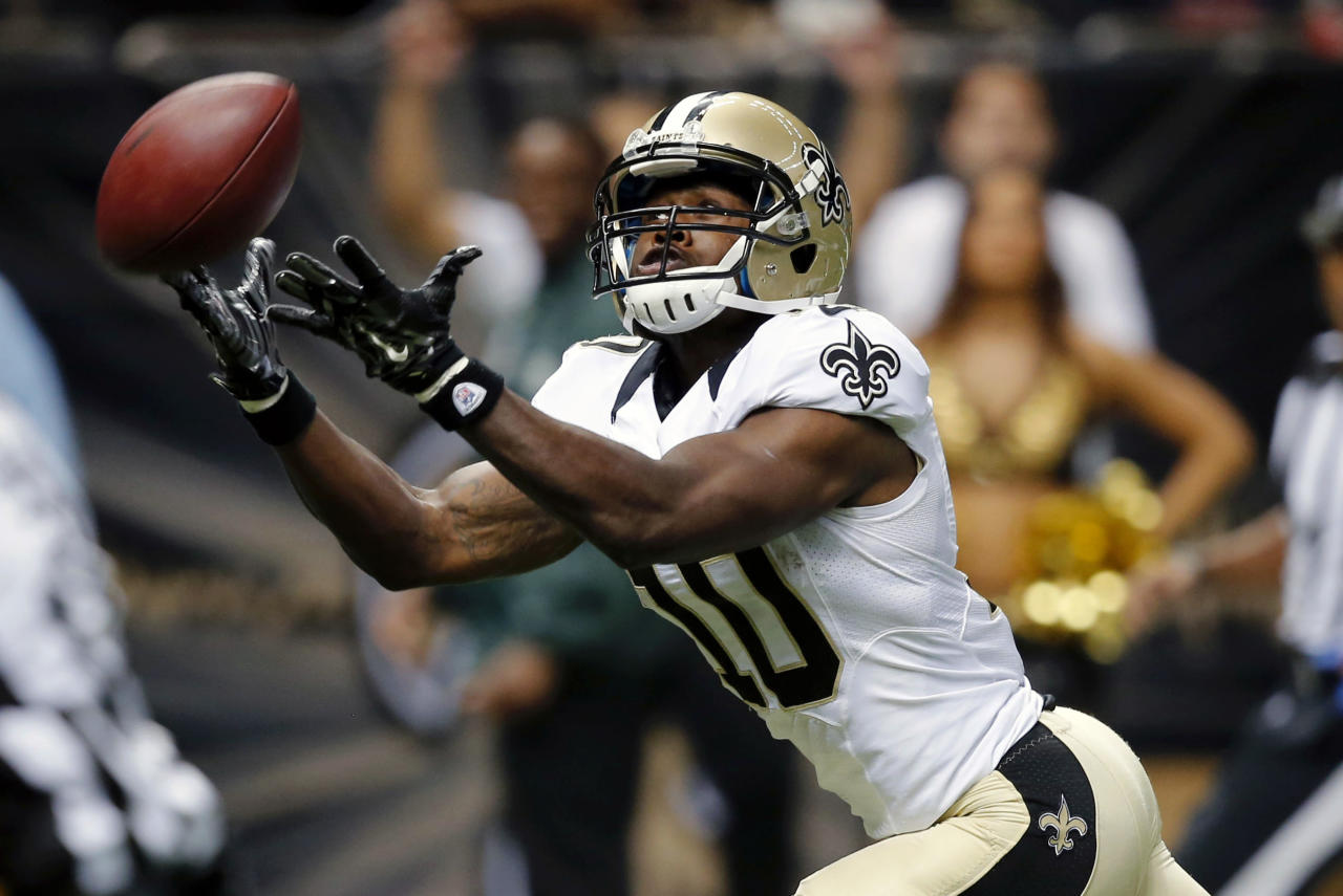 New Orleans Saints wide receiver Brandin Cooks (10) tries in vain to pull in a long pass in the second half of a NFL preseason football game against the Tennessee Titans in New Orleans, Friday, Aug. 15, 2014. (AP Photo/Bill Haber)