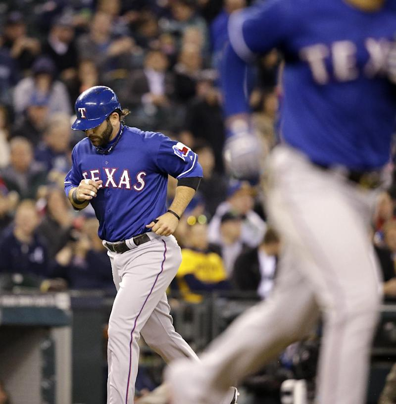 Poreda gets victory as Rangers win 6-3 over M's