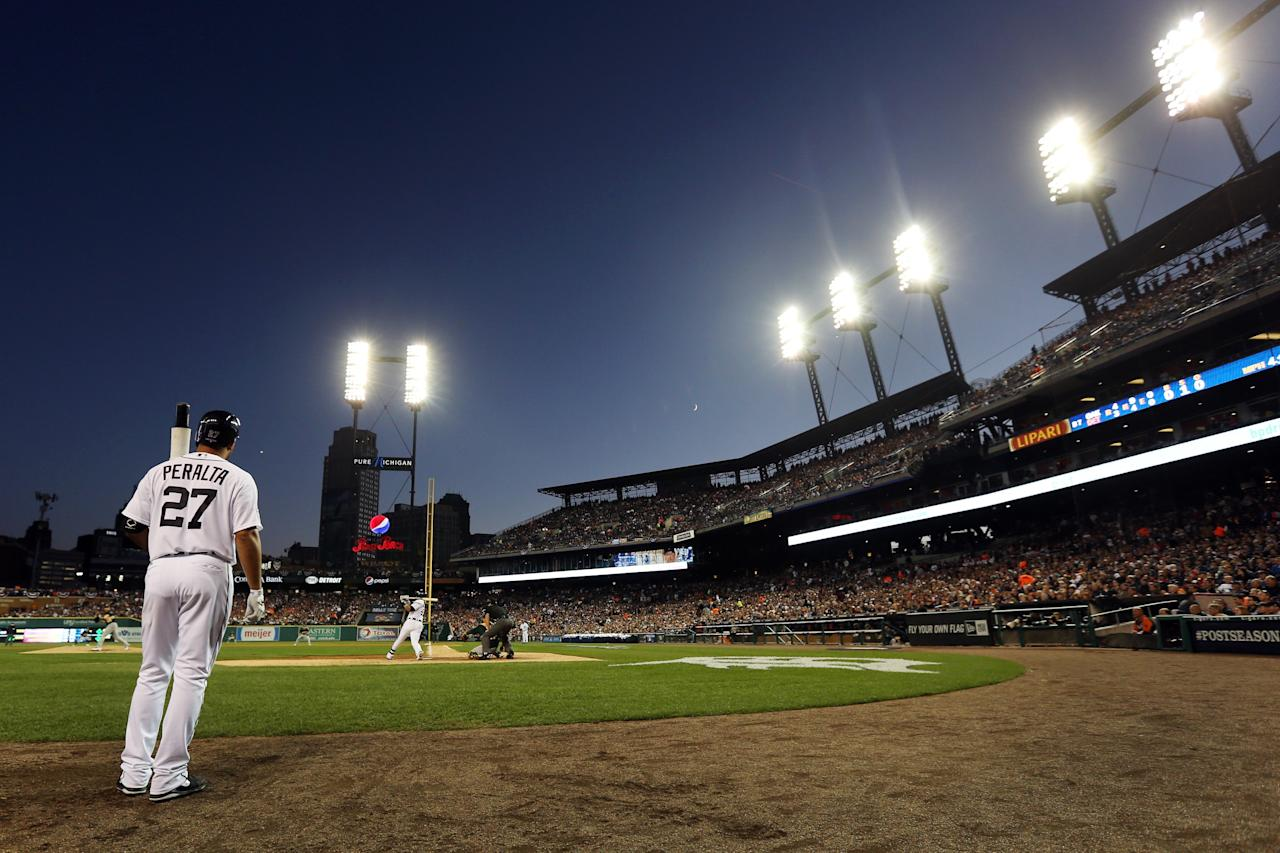 DETROIT, MI - OCTOBER 08: Jhonny Peralta #27 of the Detroit Tigers waits to bat against the Oakland Athletics during Game Four of the American League Division Series at Comerica Park on October 8, 2013 in Detroit, Michigan. (Photo by Rob Carr/Getty Images)