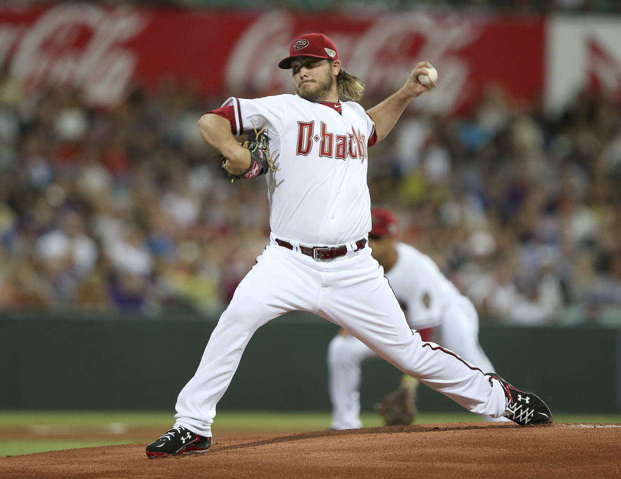 Diamondbacks' Wade Miley throws the first pitch from the opening game of the 2014 Major League Baseball season between the Los Angeles Dodgers and Arizona Diamondbacks at the Sydney Cricket Ground in Sydney, Australia Saturday, March 22, 2014. (AP Photo/Rick Rycroft)