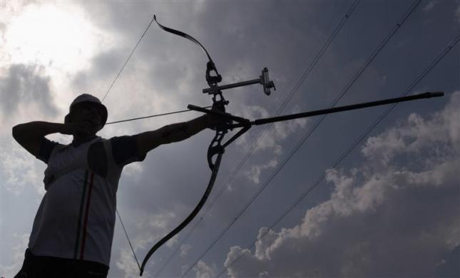 Italian Olympic team archer Marco Galiazzo prepares to release an arrow during a training session in Padua, northern Italy, April 21, 2012. Galiazzo won the gold medal in the men's individual archery event at the Athens 2004 Olympic Games, and will take part in the London 2012 Olympic Games.
