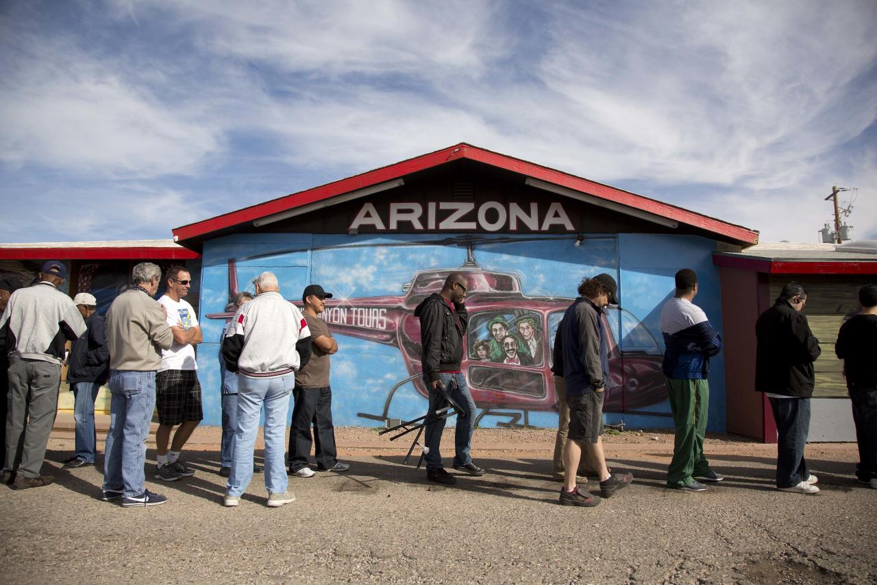 A crowd of people consisting of residents from California and Nevada lines up outside the Arizona Last Stop convenience store and souvenir shop to buy Powerball tickets, Tuesday, Nov. 27, 2012, in White Hills, Ariz. There has been no Powerball winner since Oct. 6, and the jackpot already has reached a record level for the game.   (AP Photo/Julie Jacobson)
