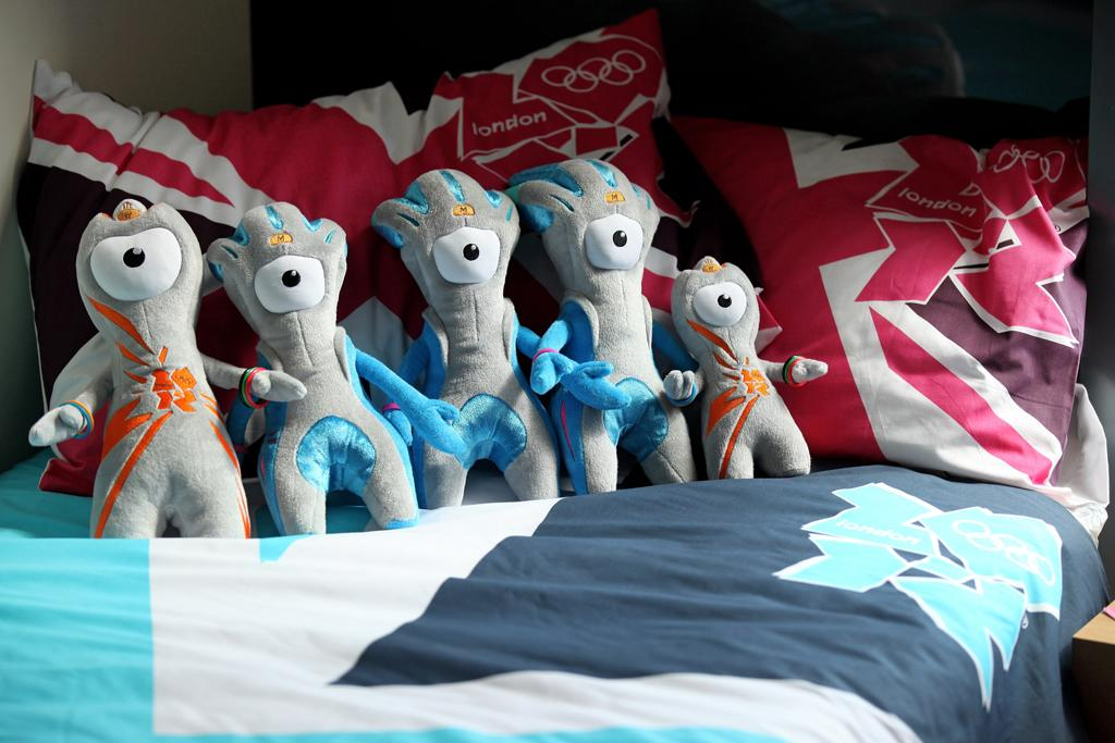 Wenlock and Mandeville, soft toy mascots for the London 2012 Olympic Games, are placed on a London 2012 bedspread at the launch of the London Olympic Games official merchandise on July 30, 2010 in London, England. The merchandise is being launched with two years to go before the Games begin and features a range of goods including: clothing, towels, bedding, ceramics, stamps, coins, badges, mascot toys and soft furnishings.  (Photo by Oli Scarff/Getty Images)