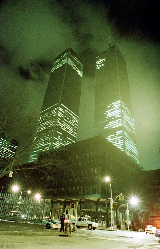 FILE - In this file photo of Feb. 26, 1993, the twin towers of the World Trade Center in New York City are shown in the aftermath of an explosion earlier that day. Twenty years ago a group of terrorists blew up explosives in an underground parking garage under one of the towers at the World Trade Center, killing six people and ushering in an era of terrorism on American soil. (AP Photo/Ron Frehm, File)
