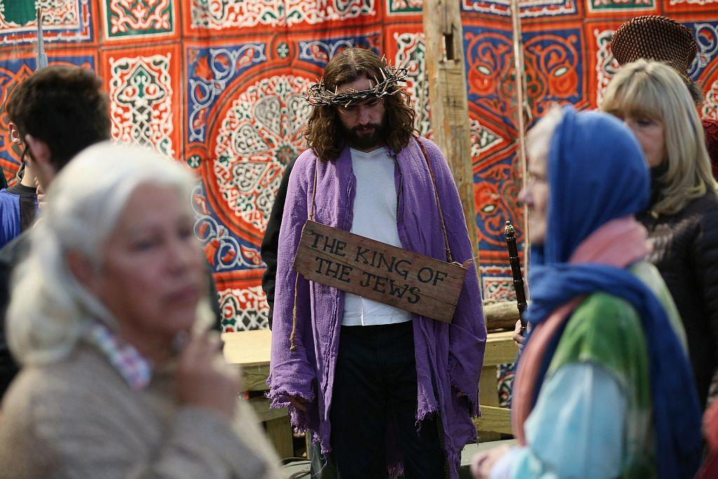 Actor James Burke-Dunsmore (C) plays Jesus in a rehearsal of 'The Passion of Jesus' by the Wintershall Players on the Wintershall estate on March 16, 2013 in Bramley, England. The Wintershall Players are based on the estate and perform several biblical theatrical productions per year. Their performance of 'The Passion of Jesus' will be performed live in Trafalgar Square, London on Good Friday, March 29, 2013. The production includes a cast of 78 actors, horses, a donkey and authentic costumes of Roman soldiers in the 12th Legion of the Roman Army.