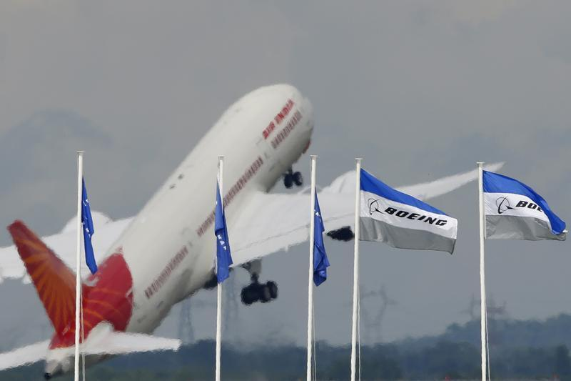 An Air India Boeing 787 Dreamliner prepares for a flying display, during the 50th Paris Air Show, at the Le Bourget airport