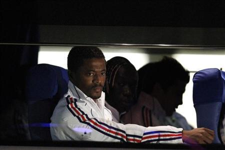 France's national Evra sits in the team bus after arriving at the airport in Bloemfontein