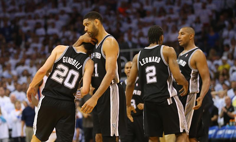 OKLAHOMA CITY, OK - MAY 31: Tim Duncan #21 of the San Antonio Spurs hugs teammate Manu Ginobili #20 after Ginobili hit a three-point shot against the Oklahoma City Thunder in the second half during Game Six of the Western Conference Finals of the 2014 NBA Playoffs at Chesapeake Energy Arena on May 31, 2014 in Oklahoma City, Oklahoma. NOTE TO USER: User expressly acknowledges and agrees that, by downloading and or using this photograph, User is consenting to the terms and conditions of the Getty Images License Agreement. (Photo by Ronald Martinez/Getty Images)