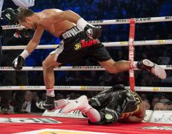 Sergey Kovalev leaps over Ismayl Sillakh after knocking him out in November. (AP)