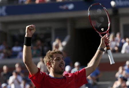 Wawrinka of Switzerland celebrates winning match point against Murray of Britain at the U.S. Open tennis championships in New York