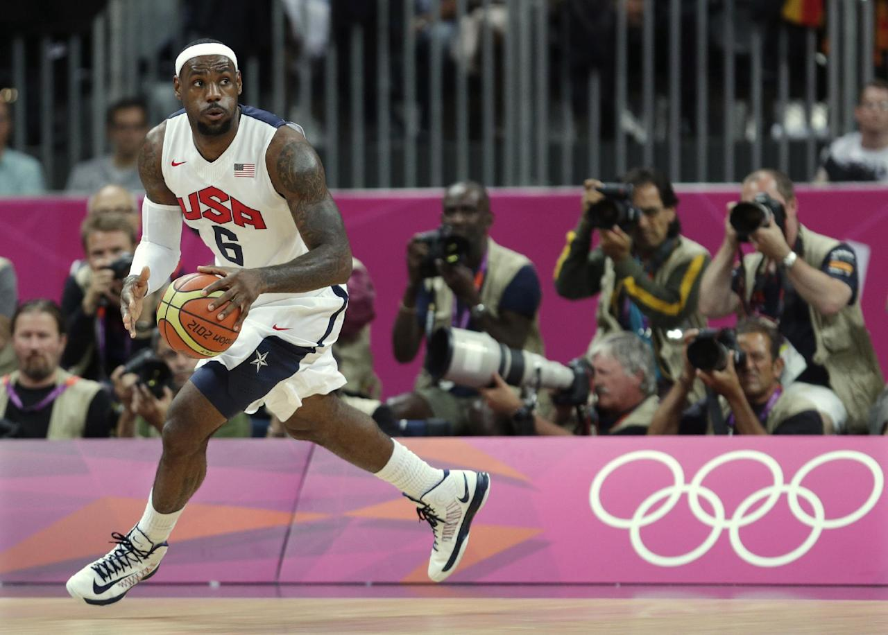 United States' Lebron James looks up the court during the first half of a preliminary men's basketball game against France at the 2012 Summer Olympics, Sunday, July 29, 2012, in London. (AP Photo/Charles Krupa)