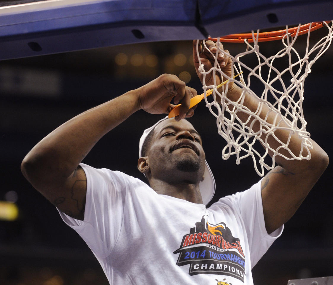 Wichita State's Chadrack Lufile cuts the net after Wichita's victory over Indiana State in an NCAA college basketball game in the championship of the Missouri Valley Conference men's tournament, Sunday, March 9, 2014, in St. Louis. (AP Photo/Bill Boyce)