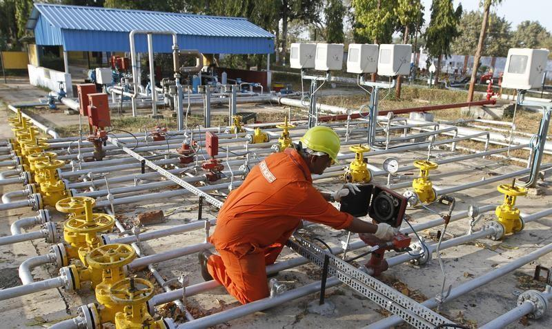 A technician works inside ONGC group gathering station on the outskirts of Ahmedabad
