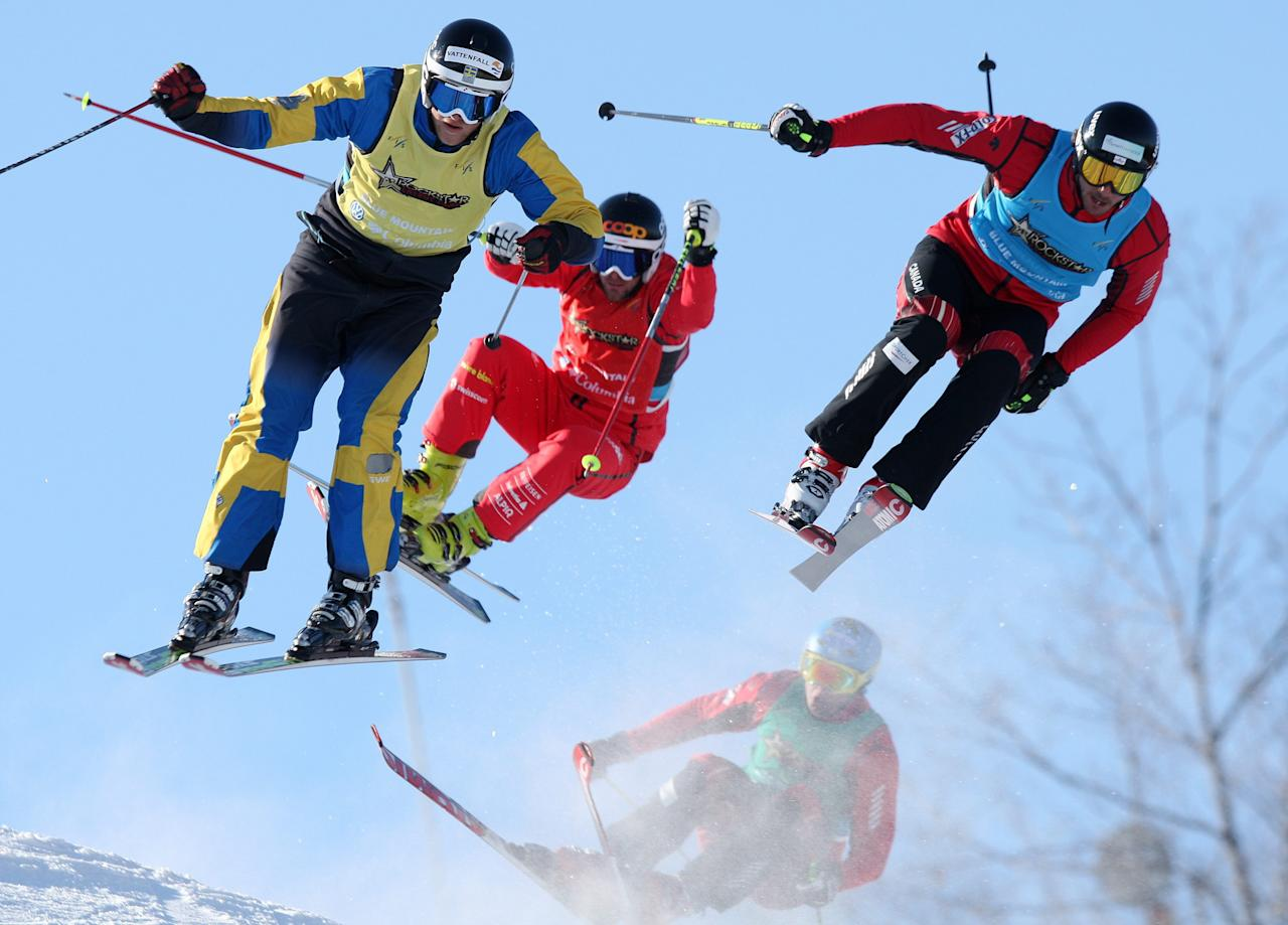 Michael Forslund of Sweden, left, Armin Neiderer of Swizerland, centre, Nick Zoricic of Canada, right, and Davey Barr of Canada, behind, fly off a jump in the Rockstar Ski Cross Grand Prix races at Blue Mountain in Collingwood, Ontario, Canada on Friday, Feb. 11, 2011.