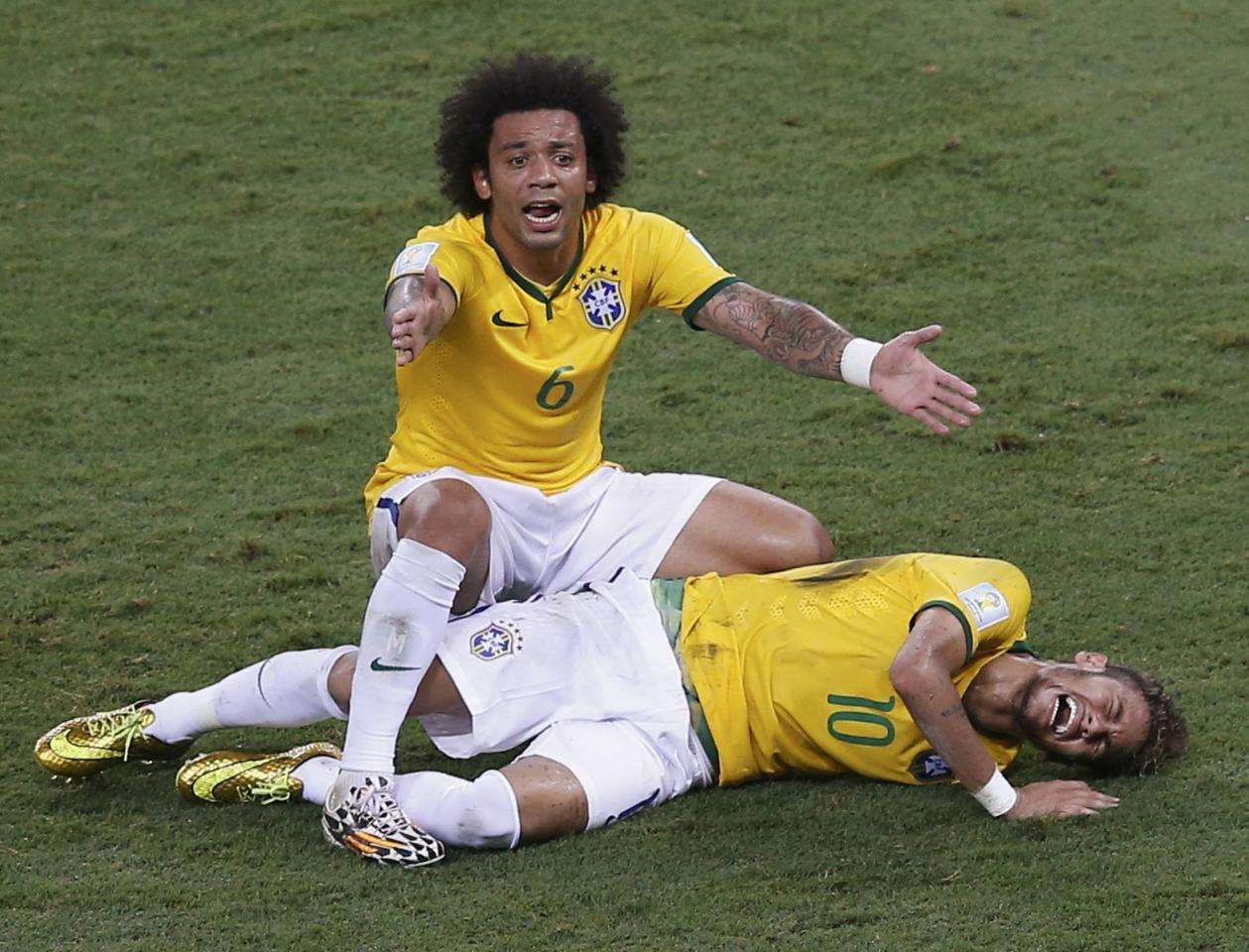 Brazil's Marcelo gestures over his injured teammate Neymar, who was fouled by Colombia's Camilo Zuniga (not pictured) during their 2014 World Cup quarter-finals at the Castelao arena in Fortaleza July 4, 2014. REUTERS/Leonhard Foeger (BRAZIL - Tags: SOCCER SPORT WORLD CUP TPX IMAGES OF THE DAY) TOPCUP