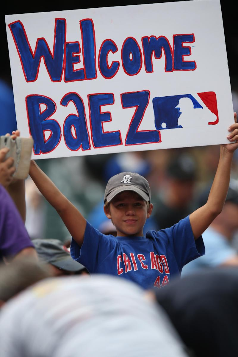 Baez hits 2 HRs, drives in 4 as Cubs beat Rockies