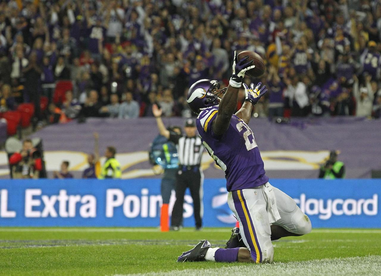 Minnesota Vikings running back Adrian Peterson (28) celebrates after scoring a 3rd quarter touchdown during the NFL football game against Pittsburgh Steelers at Wembley Stadium, London, Sunday, Sept. 29, 2013. (AP Photo/Sang Tan)