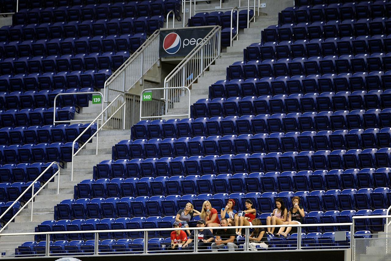 MIAMI, FL - APRIL 10:  Fans sit in a mostly empty section at Marlins Park as the Atlanta Braves play the Miami Marlins in the second inning on April 10, 2013 in Miami, Florida. The Braves defeated the Marlins 8-0.  (Photo by Marc Serota/Getty Images)