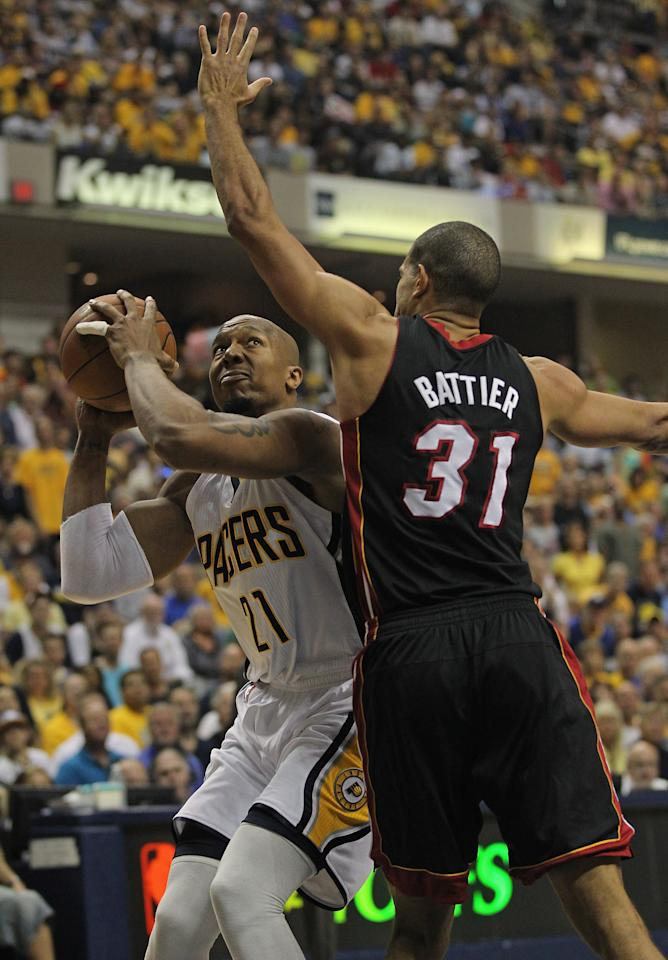 INDIANAPOLIS, IN - MAY 20: David West #21 of the Indiana Pacers tries to get off a shot against Shane Battier #31 of the Miami Heat in Game Four of the Eastern Conference Semifinals in the 2012 NBA Playoffs at Bankers Life Fieldhouse on May 20, 2012 in Indianapolis, Indiana. NOTE TO USER: User expressly acknowledges and agrees that, by downloading and/or using this photograph, User is consenting to the terms and conditions of the Getty Images License Agreement.  (Photo by Jonathan Daniel/Getty Images)