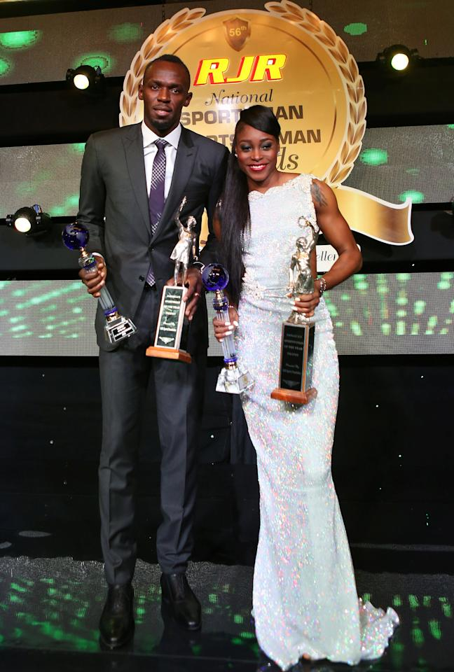 Jamaican sprinter Usain Bolt and fellow sprinter Elaine Thompson pose after being presented with their awards during the National Sportsman and Sportswoman of the Year 2016 award ceremony in Kingston, Jamaica January 13, 2017. Picture taken January 13, 2017. REUTERS/Gilbert Bellamy