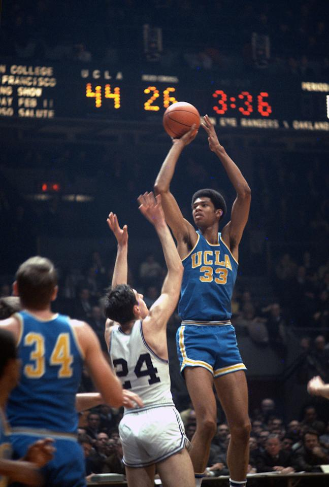 Kareem Abdul-Jabaar, then known as Lew Alcindor, of the UCLA Bruins in action shooting over a defender during an NCAA basketball game circa 1968. Alcindor played for the UCLA from 1965-69. (Photo by Focus on Sport/Getty Images)