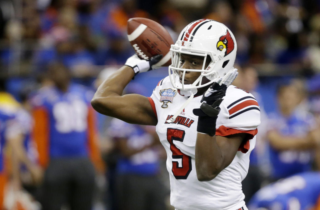 Louisville quarterback Teddy Bridgewater (5) throws prior to the start of the Sugar Bowl NCAA college football game against Florida on Wednesday, Jan. 2, 2013, in New Orleans. (AP Photo/Bill Haber)