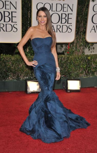 """<div class=""""caption-credit""""> Photo by: Getty Images</div><div class=""""caption-title"""">Sofía at the Globes</div>The star of """"Modern Family"""" radiated sex appeal in this strapless Vera Wang gown. And while her accessories were minimal, the Colombian actress (who reportedly doesn't go out without her """"bling bling"""") paired her deep blue dress with Harry Winston jewelry worth over five million dollars."""