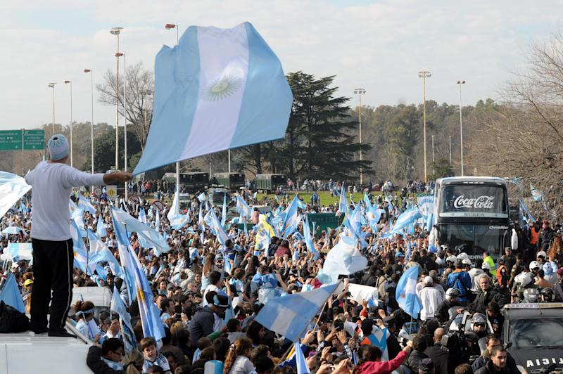 A crowd of Argentinian fans greet their national football team upon their arrival, near Ezeiza, province of Buenos Aires, Argentina after playing against Germany in the World Cup Brazil 2014 final, on July 14, 2014