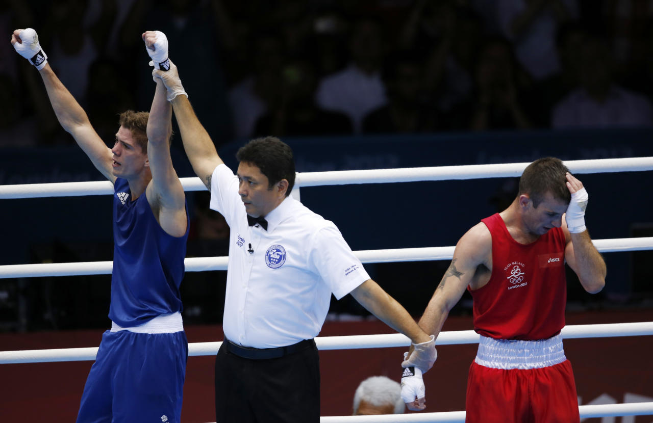 Britain's Luke Campbell (L) is declared the winner over Ireland's John Joe Nevin after their Men's Bantam (56kg) gold medal boxing match at the London Olympics August 11, 2012.    REUTERS/Murad Sezer (BRITAIN  - Tags: SPORT BOXING OLYMPICS)