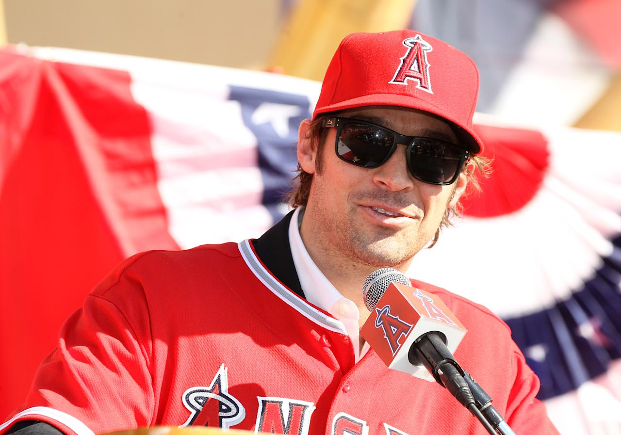 ANAHEIM, CA - DECEMBER 10:  C.J. Wilson speaks at a public press conference introducing newly signed Los Angeles Angels of Anaheim  players Albert Pujols and Wilson at Angel Stadium on December 10, 2011 in Anaheim, California.  (Photo by Stephen Dunn/Getty Images)