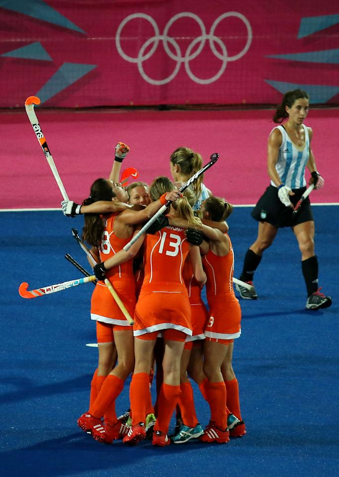 LONDON, ENGLAND - AUGUST 10:  Maartje Paumen #17 of Netherlands celebrates with teammates after scoring a goal in the second half against Argentina during the Women's Hockey gold medal match on Day 14 of the London 2012 Olympic Games at Hockey Centre on August 10, 2012 in London, England.  (Photo by Daniel Berehulak/Getty Images)