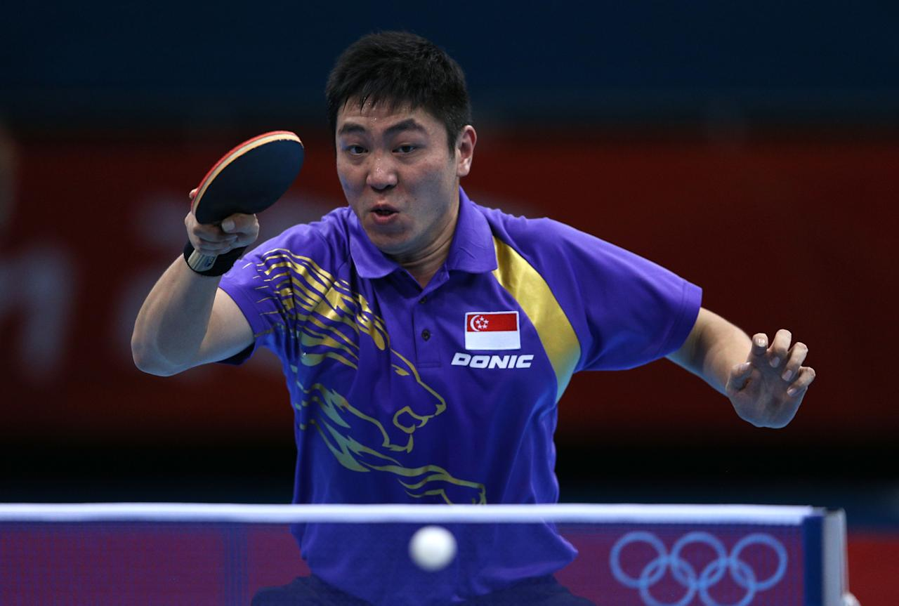 LONDON, ENGLAND - JULY 30:  Ning Gao of Singapore returns the ball during his Men's Singles Table Tennis fourth round match against Wang Hao of China on Day 3 of the London 2012 Olympic Games at ExCeL on July 30, 2012 in London, England.  (Photo by Feng Li/Getty Images)