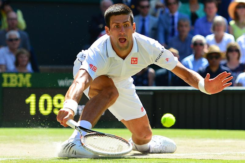 Serbia's Novak Djokovic returns to Bulgaria's Grigor Dimitrov during their men's singles semi-final match during the 2014 Wimbledon Championships in London on July 4, 2014
